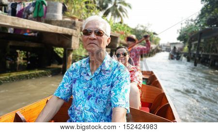 Asian Elderly Couple Having Fun Retirment Trip Around The World