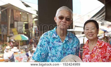 Asian Senior Couple Having Fun Retirment Trip Around The World
