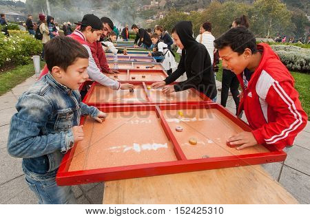 TBILISI, GEORGIA - OCT 16, 2016: Happy kids playing board game on the playground of Tbilisoba festival on October 16, 2016. Tbilisoba is traditional festival in capital of Georgia from 1979