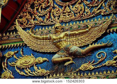 Phuket City Thailand - January 8, 2011: A gilded Thai Phoenix decorates the Ubosot Sanctuary Hall at Wat Mongkhol *