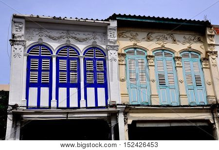 Phuket City Thailand - January 8 2012: Rarly 20th century Sino-Portuguese shop houses with louvered wooden shutters and decorative pargetting in the Krabi Road historic district