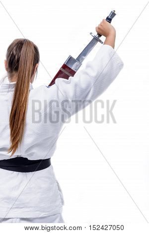 Young athlete hand martial arts hold a sword.