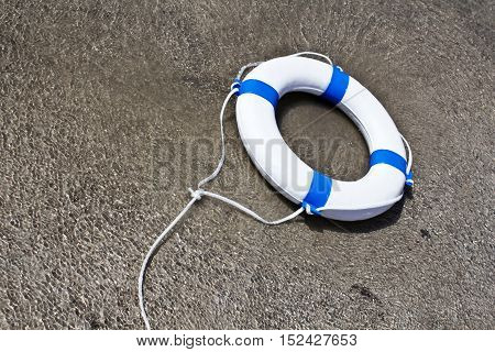 Nautical lifebuoy lifebelt life saver in clear water floating