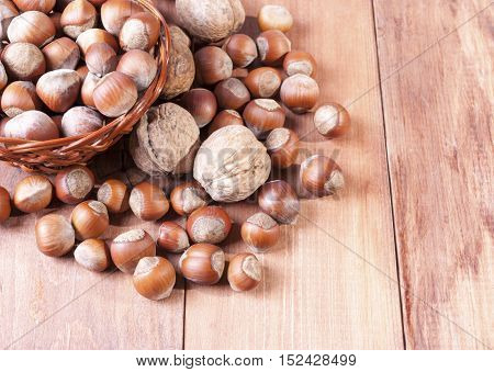 Hazelnuts in a basket on a wooden table