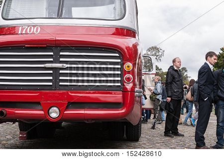 Saint Petersburg Russia September 17 2016: People visiting the old buses in the exhibition in St. Petersburg Russia