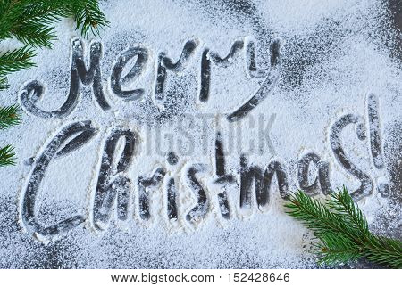 Merry Christmas - Christmas food background with an inscription. Top view .