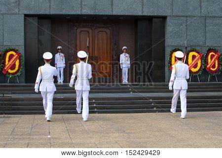 HANOI, VIETNAM - JANUARY 10, 2016: Change of time of the guard at the entrance to the Ho Chi Minh mausoleum. Historical landmark of the city Hanoi, Vietnam