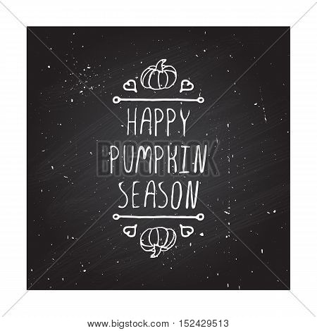 Hand-sketched typographic element with pumpkin, maple leaves and text on blackboard background. Happy pumpkin season