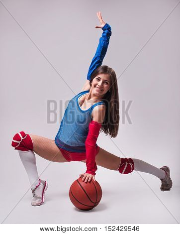 Young Sexy Female Holing Basketball Ball