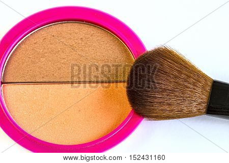 Close up of a make up powder and a brush on white background.