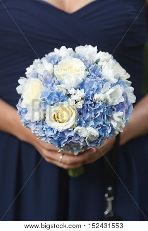 Blue and white bridal bouquet of hydrangea, roses and freesia flowers