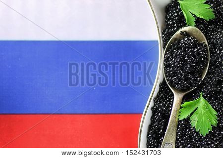 traditional russian snack black caviar on a wooden background