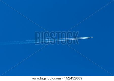 Reversing The Trace Of The Plane In The Blue Sky Without Clouds