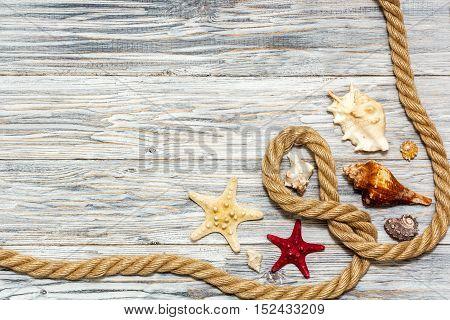 Marine rope and starfish on white boards flat lay