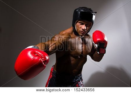 Close-up Portrait Of Young Man With Boxing Helmet