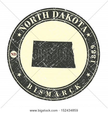 Vintage stamp with map of North Dakota. Stylized badge with the name of the State year of creation the contour maps and the names abbreviations . Vector illustration