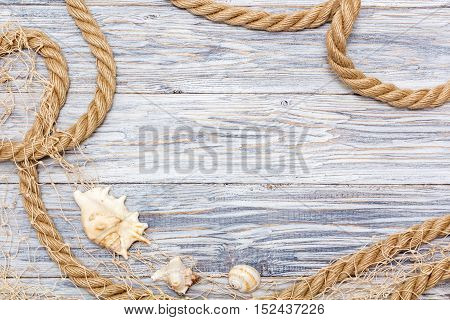 Marine rope and shell on white boards flat lay