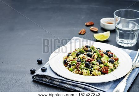 Quinoa avocado blueberry pecan salad with maple syrup lime dressing