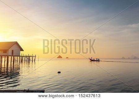 wooden house on sea sunny sunset sky