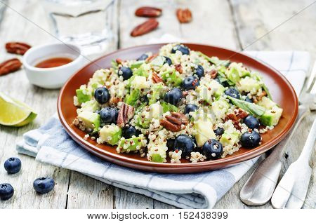 Quinoa avocado blueberry pecan salad with maple syrup lime dressing.
