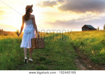 portrait of a cute beautiful girl of European appearance on nature in a summer day