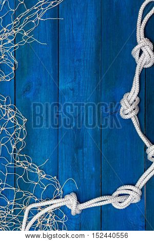 Marine Network and rope on blue boards flat lay