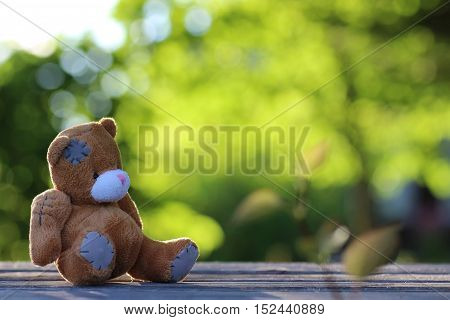 old retro soft toy teddy bear on a table