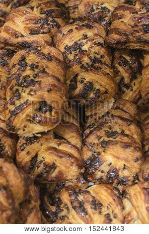 Freshly baked goods in organic bakery closeup.