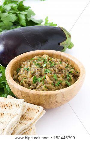 Eggplant baba ganoush and ingredients isolated on white background
