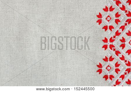 Embroidered pattern by red and white cotton threads for background or cover.  Christmas background with embroidery.