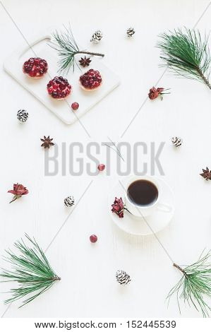 Christmas composition. Cup of coffee christmas dessert anise star pine branches. Top view