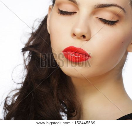 Beautiful young model with red lips over white background