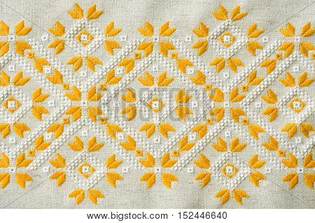 Texture of the vintage embroidery. Design of ethnic pattern. Background with embroidery. Geometric ornament.