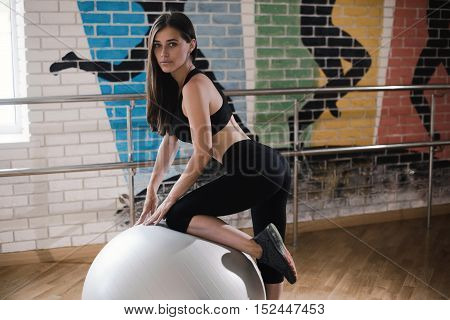 Woman In Black Wear Exercising On A Pilates Ball. Fitball