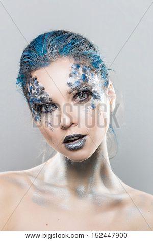 fashion portrait. girl posing in the Studio. Creative make-up