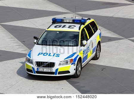 Stockholm, Sweden - June 24, 2014: Swedish police car a Volvo V70 parked at Sergel's Torg in Stockholm.