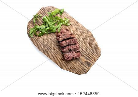 Slice of meat on wood board. Top view. Isolated on white. Path included