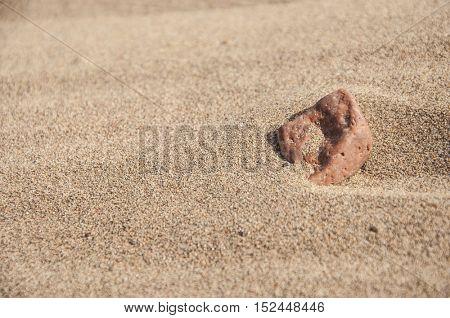 stone on the seashore at sun