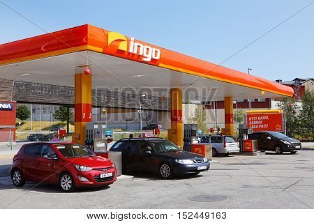 Sodertalje, Sweden - July 26, 2014: Cars refueling at the unmanned station associated with the gasoline brand Ingo at Sodertalje syd..