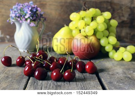 bright juicy ripe delicious fruit on an old wooden table