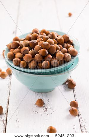 Hazelnuts on rustic wooden background healthy food