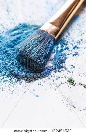Macro photo of eye shadow with brush on white background