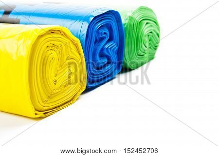 Colored garbage bags on white background. garbage bags