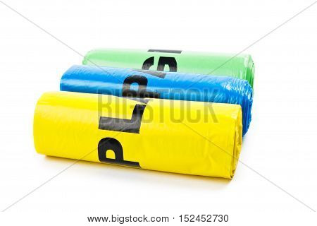 Three colored garbage bags on white background