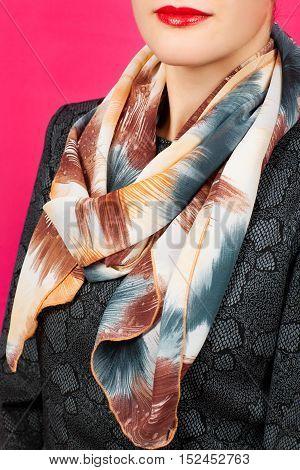 Silk Scarf. Beige Silk Scarf Around Her Neck Isolated On Pink Background.