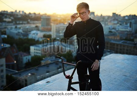 Man With A Bicycle On Sunset Background
