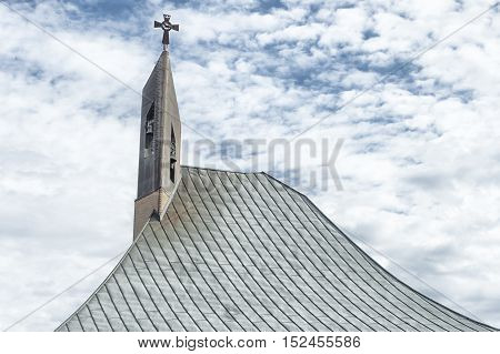 Steeple detail of a modern church catholic religion Italy