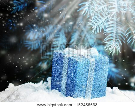 The magic of Christmas night gift in the snow under the tree Christmas
