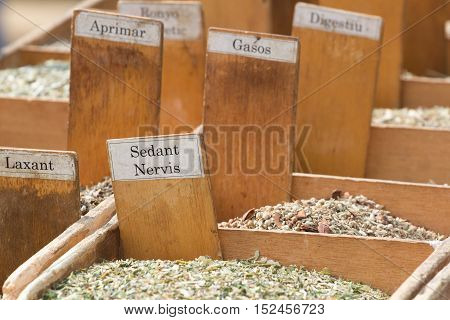 Mixture of herbs from various diseases spread out on the market in wooden box
