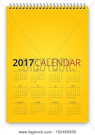 Simple calendar 2017 yellow colored template. Week starts from sunday. Vector realistic spiral notepad notebook